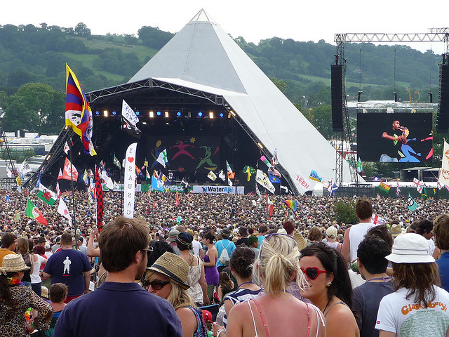 Crowds walking around at Glastonbury Festival in UK