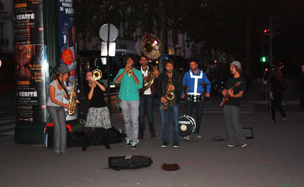 A Band Playing On The Street In Paris